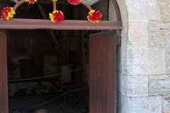 Condat, door of old flour mill open and decorated for the medieval fayre 2017.