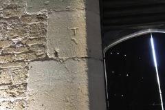 Upper block, Initials T, IH, gouged dots.