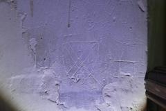 Shield, circles (hand drawn), bird, other marks
