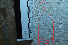 12. St Giles. Southeast face of the 3rd pillar from the west a cross ladder mark under the paint.