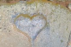 Heart-shaped date stone on barn, 1743
