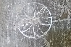 Daisy wheel compass drawn exterior, possible hand drawn interior.