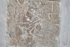 Markings on stone on exterior of alcove