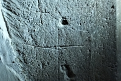 C18) Porch outer Ddorway east northeast face.  Two crosses.