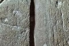 C3) Porch inner doorway east side southwest face. A Cross