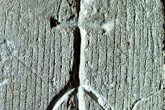 C4) Porch inner doorway  east side southwest face. A Cross.