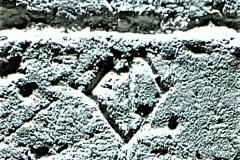V2) Porch inner doorway east side southwest face. A diamond shape.