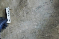Tower stairs top, names, dates.