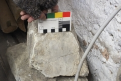 O10) Ringing chamber.  A mason's location mark on a piece of reclaimed stone.