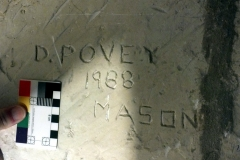 O11) Tower stair, upper section.  The mark of a modern mason D. POVEY 1988 MASON.