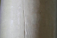 UA01) North rectangular pillar, north west side. These could be three intersecting apotropaic lines of a thin arrow head.