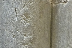UA08)  South rectangular pillar, west circular column.  Various marks.