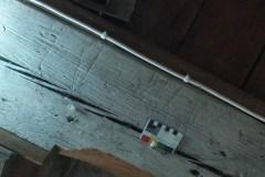 Faint marks underside of floor beam of bell chamber