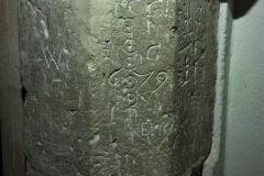 Incised circles, date 1679