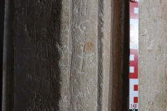 Incised circles, initials WC, NW, crossed I, end of tail of long tailed cross/star