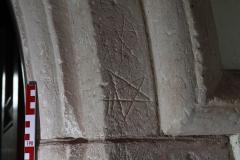 N door arch west side, stars, criss cross,initials R,P,M.