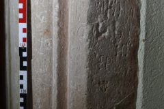 Lower part N. doorway. Scores, small shield?  Gouges, initials P,H,T,K, criss-cross