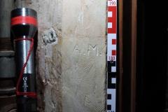 Tower door arch LHS initials AM